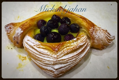 Delicate laminated pastry filled with creme patissiere and blueberries